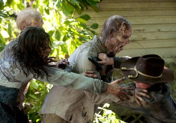 Walkers and Carl Grimes (Chandler Riggs)  - The Walking Dead - Season 4, Episode 9 Photo Credit: Gene Page/AMC