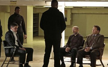 """Asylum"" -- Reese (Jim Caviezel, seated left) and Fusco (Kevin Chapman, seated right) get caught in the war between the two newest POIs, rival crime bosses Elias (Enrico Colantoni, seated) and Dominic (Winston Duke, standing, center), on PERSON OF INTEREST, Tuesday, April 28 (10:01-11:00 PM, ET/PT) on the CBS Television Network.  Photo: Giovanni Rufino/Warner Bros. Entertainment Inc. © 2015 WBEI. All rights reserved."
